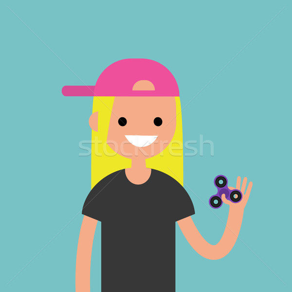 Young female character spinning a hand toy. Stress relieving toy Stock photo © nadia_snopek