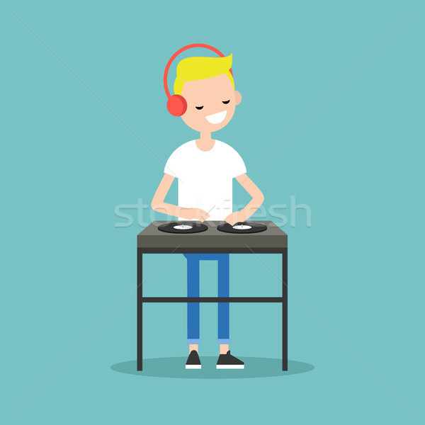 Young blond DJ wearing headphones and scratching a record on the Stock photo © nadia_snopek