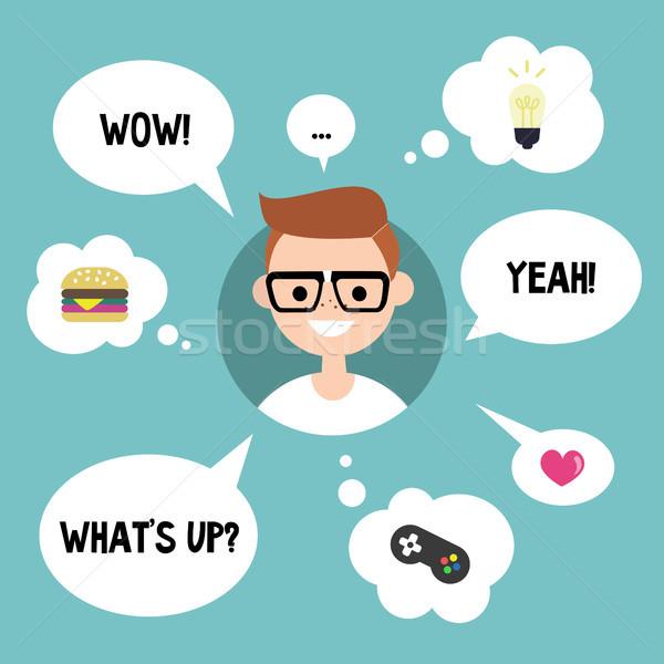 Modern communication concept. Happy nerd surrounded by speaking  Stock photo © nadia_snopek