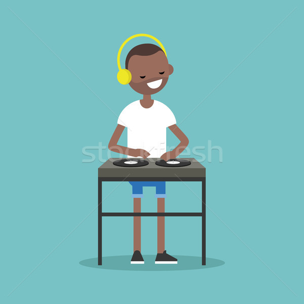 Young black man wearing headphones and scratching a record on th Stock photo © nadia_snopek