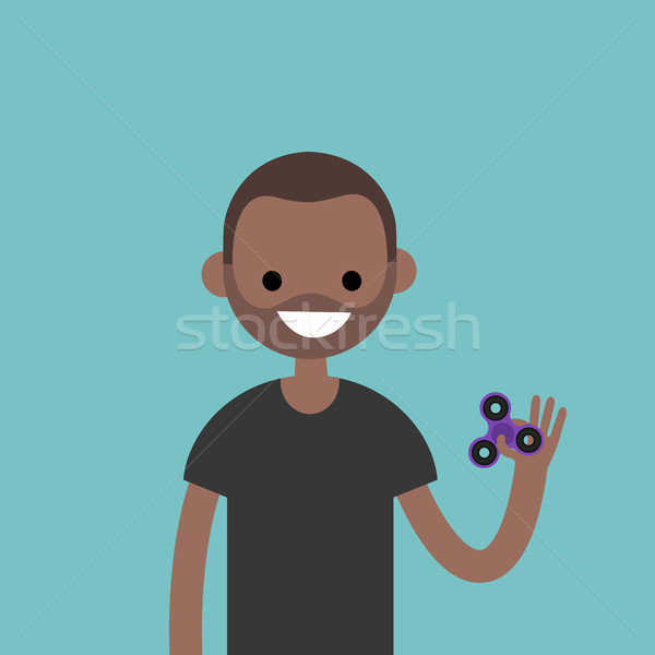 Young black character spinning a hand toy. Stress relieving toy  Stock photo © nadia_snopek