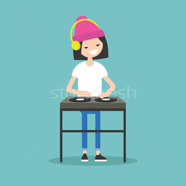 Young girl DJ wearing headphones and scratching a record on the  Stock photo © nadia_snopek