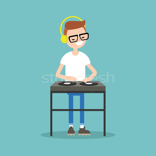 Young nerd wearing headphones and scratching a record on the tur Stock photo © nadia_snopek