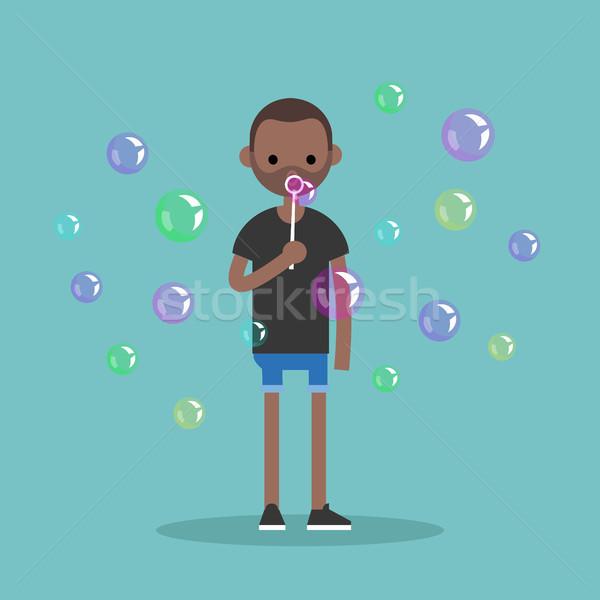 Jonge zwarte karakter zeepbellen Stockfoto © nadia_snopek