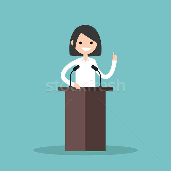 Brunette girl standing behind the tribune and pointing her finge Stock photo © nadia_snopek