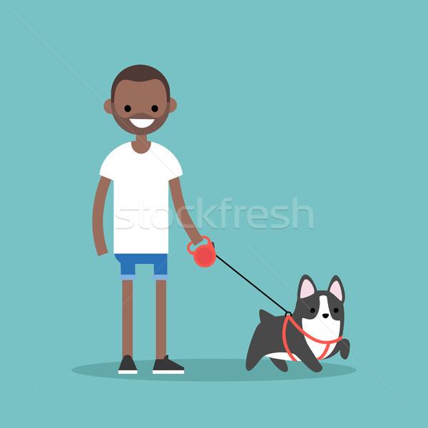 молодые улыбаясь черным человеком ходьбе собака Сток-фото © nadia_snopek