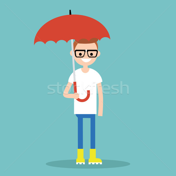 Young smiling character with umbrella wearing yellow rubber boot Stock photo © nadia_snopek