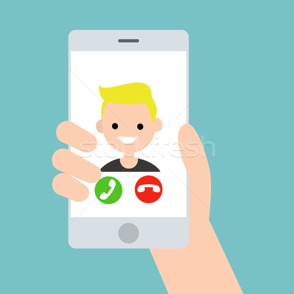 Hand holding a smart phone. Incoming call from young blond boy / Stock photo © nadia_snopek