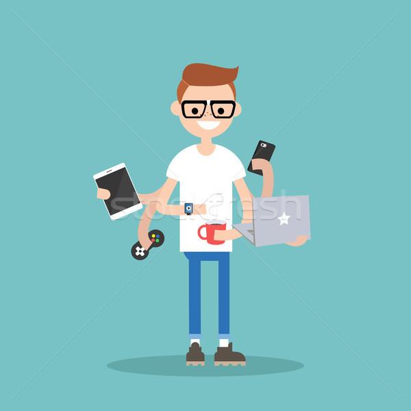 Multitarefa jovem nerd dispositivos tempo trabalhar Foto stock © nadia_snopek