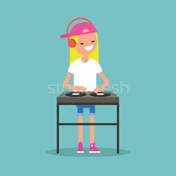 Young blond girl DJ wearing headphones and scratching a record o Stock photo © nadia_snopek