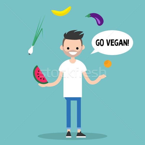 Modern lifestyle. Go vegan. Young bearded man juggling fruits an Stock photo © nadia_snopek