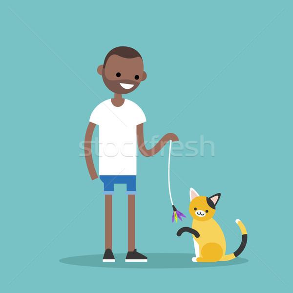 Jonge zwarte karakter spelen kat Stockfoto © nadia_snopek