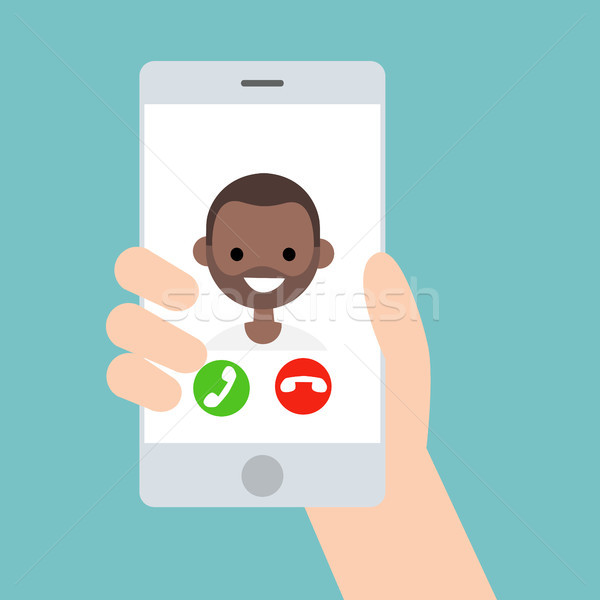 Hand holding a smart phone. Incoming call from young black boy/  Stock photo © nadia_snopek
