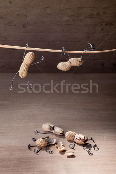 потеряли баланса миниатюрный арахис люди Сток-фото © nailiaschwarz