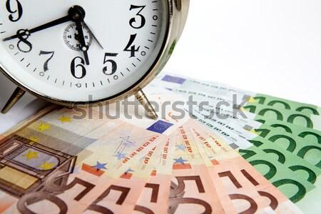 Tijd is geld shot oude mechanisch wekker euro Stockfoto © nailiaschwarz