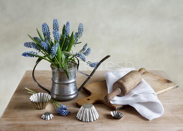 Kitchen still life with grape hyacinths Stock photo © nailiaschwarz