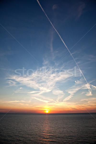 日没 海 キャップ ビーチ 空 水 ストックフォト © nailiaschwarz
