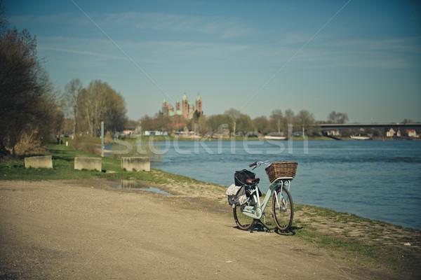 Bicycle at the Rhine Stock photo © nailiaschwarz