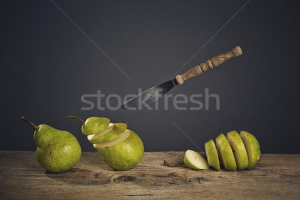 Sliced Pears and flying Knife Stock photo © nailiaschwarz