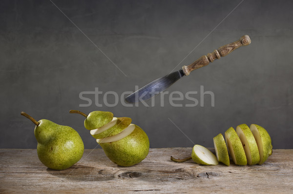 Sliced Pears and flying Knife Stock photo © nailiaschwarz