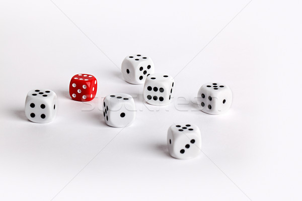 Bianco dadi uno rosso individualità gioco Foto d'archivio © nailiaschwarz