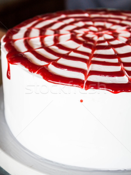 Rasberry sauce topped white whipped cream cake  Stock photo © nalinratphi