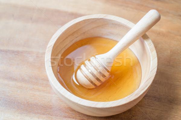 Golden honey cup and dipper Stock photo © nalinratphi