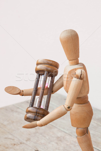 Wood mannequin and hourglass display  time management Stock photo © nalinratphi