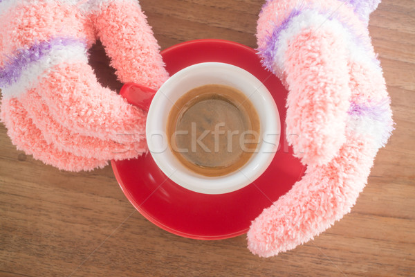 Stock photo: Gloved hands holding cup of coffee