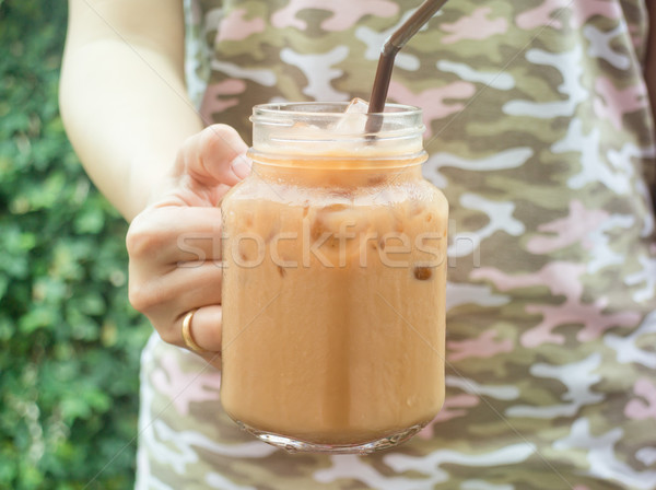 Hand hold glass of iced coffee with vintage filter effect Stock photo © nalinratphi