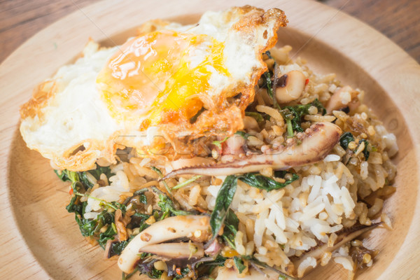 Rice topped with stir-fried squid basil and fried egg (Thai food Stock photo © nalinratphi