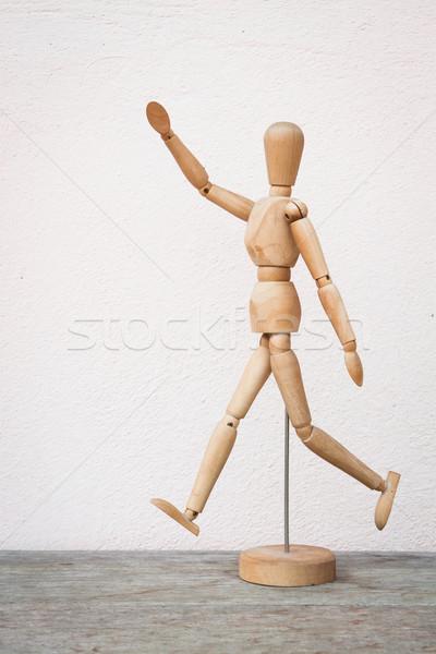 Wooden figure pose as happy jumping forward Stock photo © nalinratphi