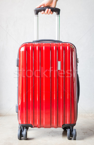 Hand on red travelling suitcase Stock photo © nalinratphi