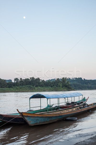 Wooden long tail boats Stock photo © nalinratphi