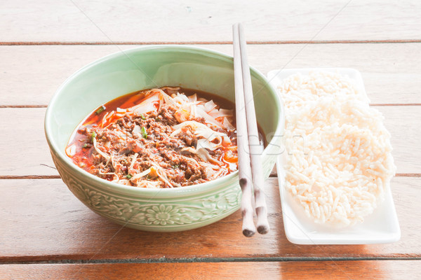Traditional meal of spicy noodle and crispy rice cracker Stock photo © nalinratphi