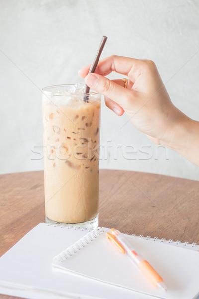 Hand hold straw of ice coffee Stock photo © nalinratphi