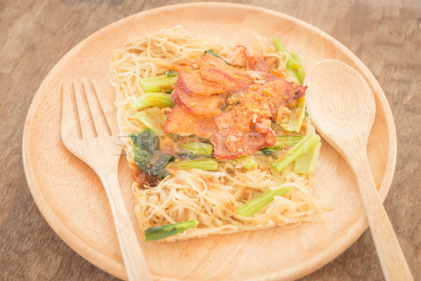 Wheat noodles with barbecued red pork Stock photo © nalinratphi