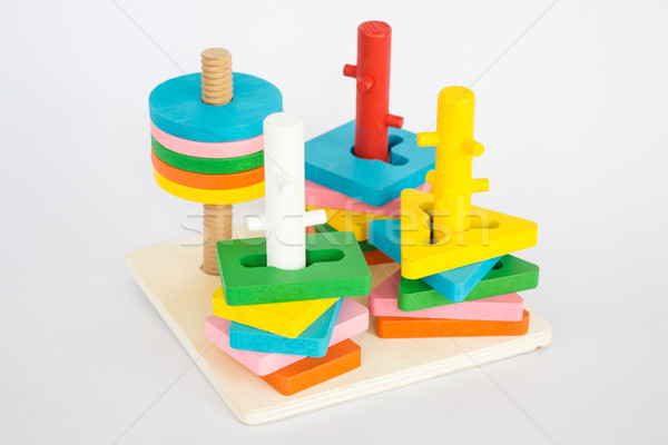 Colorful puzzle wooden toy on white table Stock photo © nalinratphi
