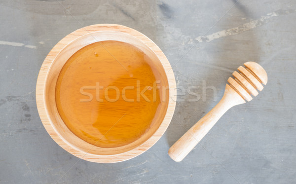 Golden honey cup and dipper on top view Stock photo © nalinratphi