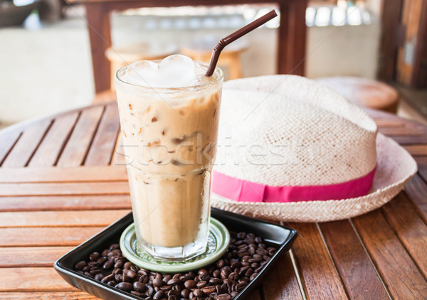 Cold glass of iced milk coffee with ice cube   Stock photo © nalinratphi