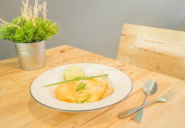 Pad Thai, stir-fried rice noodles with egg Stock photo © nalinratphi