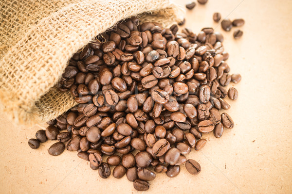 Coffee roasted bean in the sack on wooden background Stock photo © nalinratphi
