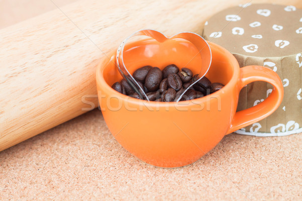 Heart cookies cutter in cup of coffee bean   Stock photo © nalinratphi