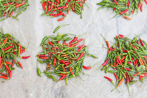 Lots of spicy red and green hot chili peppers  Stock photo © nalinratphi