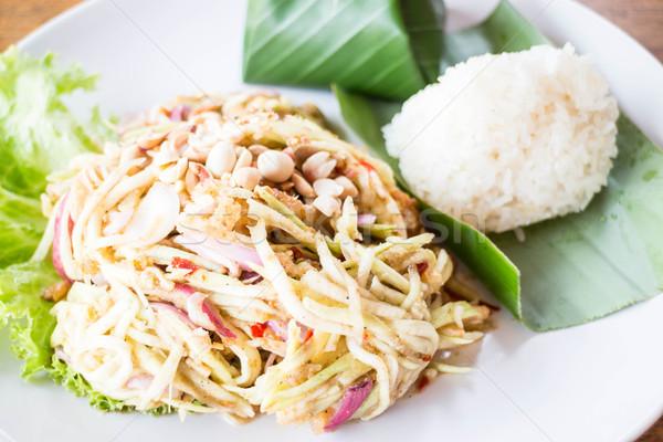 Mango spicy salad and sticky rice Stock photo © nalinratphi