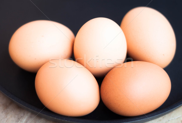 Egg group in a black tray Stock photo © nalinratphi