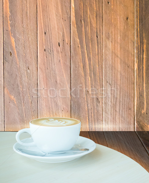 Coffee latte cup on corner of wooden background Stock photo © nalinratphi