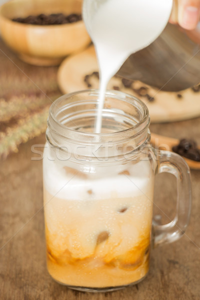Milk pouring for fresh iced coffee Stock photo © nalinratphi