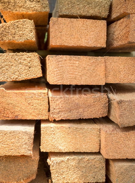 Wood log for construction buildings background Stock photo © nalinratphi
