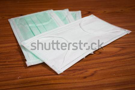Medical sanitary mask on wood background Stock photo © nalinratphi